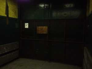 This is actually the freight elevator, which is bigger, just as poorly lit, and has no graffiti. The older elevator is being replaced now.